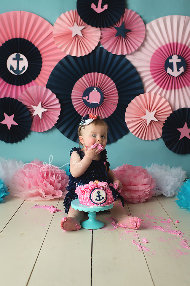 Nautical Pink & Navy Smash Cake Photography Session | Paper Fan Backdrop | Connecticut Smash Cake photographer Elizabeth Frederick Photography www.elizabethfrederickphotography.com | Nautical First Birthday Girl